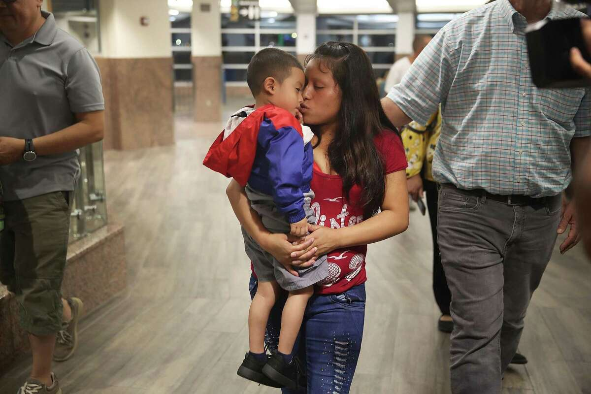A woman, identified as Maria, is reunited with her son Franco, 4, in El Paso on July 26. Maria, from Guatemala, was reunited with Franco after being separated for one month.