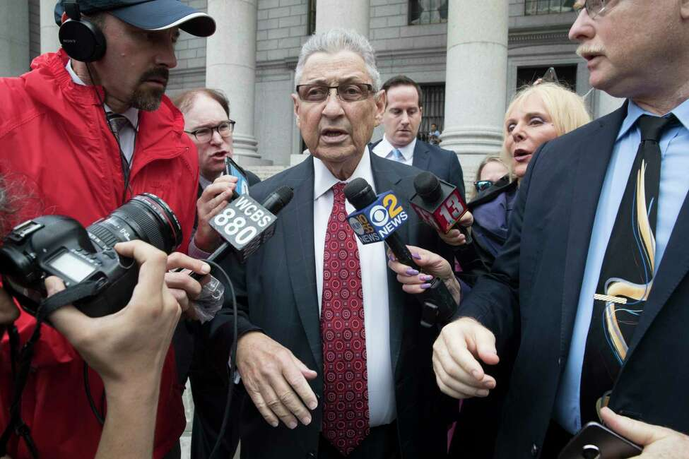 Former New York Assembly Speaker Sheldon Silver, center, is surrounded by reporters as he leaves federal court in New York after his sentencing, Friday, July 27, 2018. Silver, a former New York Assembly speaker who brokered legislative deals for two decades before criminal charges abruptly ended his career, was sentenced Friday to seven years in prison by a judge who said political corruption in the state