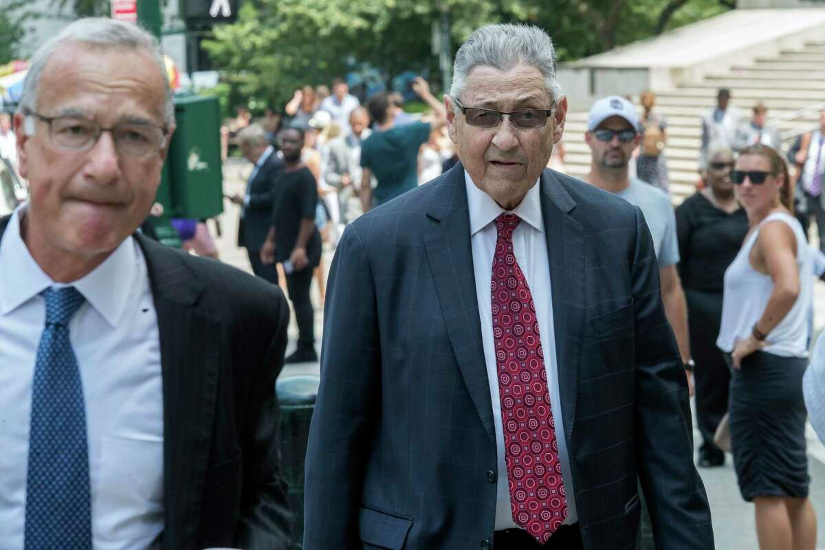 Former New York Assembly Speaker Sheldon Silver, right, arrives at federal court in New York, Friday, July 27, 2028. Silver, the former New York Assembly speaker who brokered legislative deals for two decades before corruption charges abruptly ended his career, will be sentenced for a second time Friday. (AP Photo/Mary Altaffer)