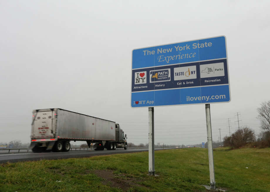 Federal officials say the road signs, as this one along the New York State Thruway, are illegal because they are jammed with words and information that may distract drivers. (Mike Groll/Associated Press) Photo: Mike Groll