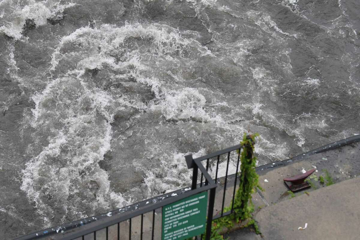 Storm runoff flows into the Hudson River at State Str. on Friday, July 26, 2018, in Troy, N.Y. (Will Waldron/Times Union)