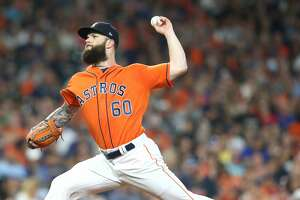 Houston Astros starting pitcher Dallas Keuchel (60) pitches in the fourth inning against the Texas Rangers at Minute Maid Park on Friday, July 27, 2018 in Houston.