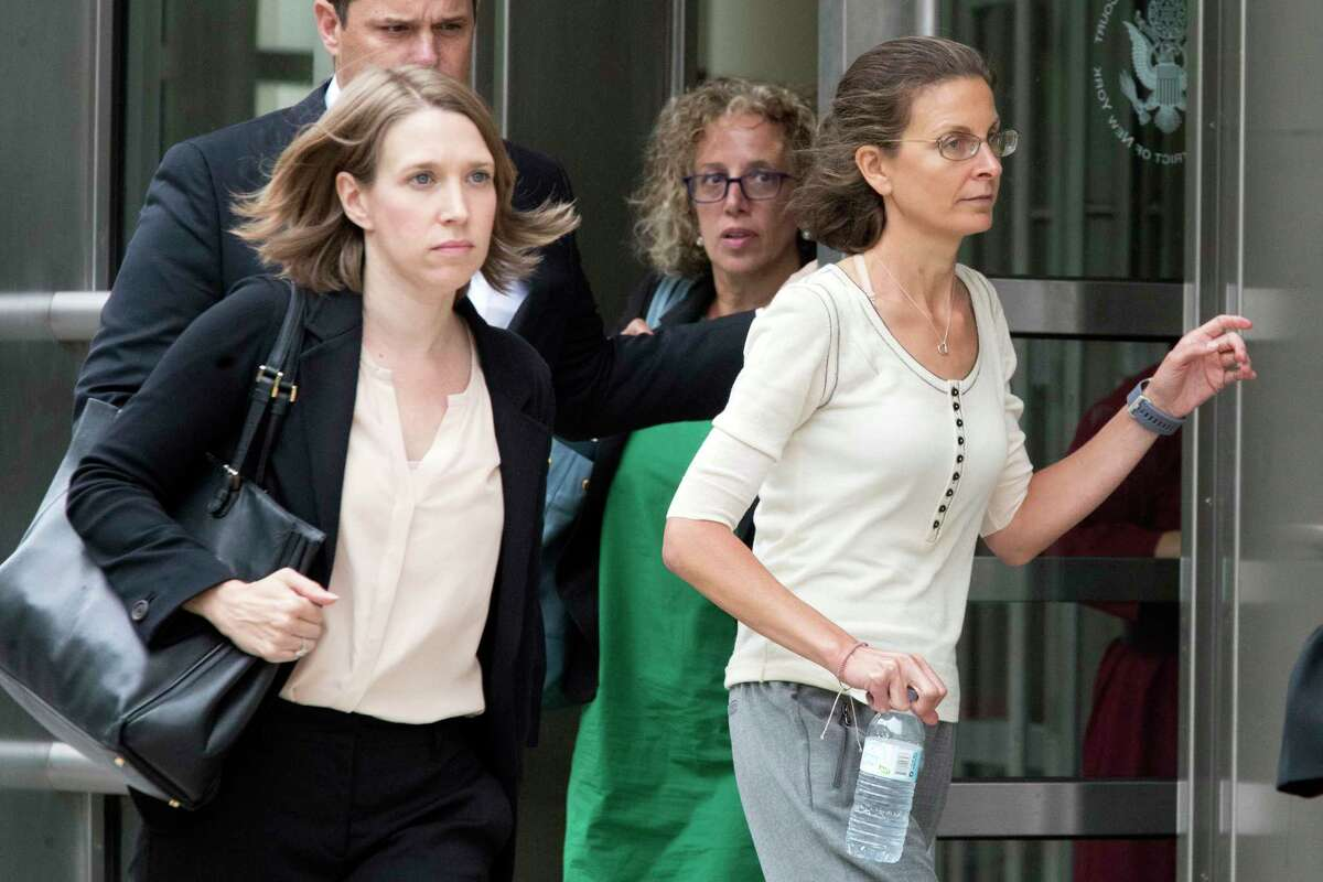 Clare Bronfman, right, leaves federal court with her attorney Susan Necheles, Wednesday, July 25, 2018, in the Brooklyn borough of New York. (AP Photo/Mary Altaffer)