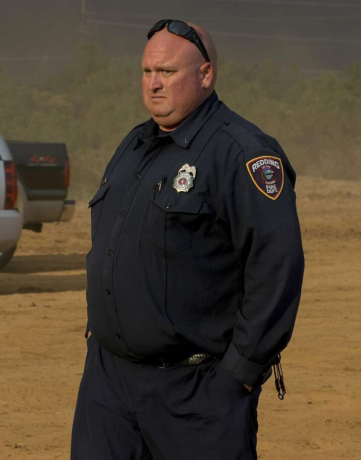 This Thursday, June 26, 2018, photo released by Casey Lansdon shows Redding fire inspector Jeremy Stoke in Redding, Calif. A wildfire roared with little warning into the Northern California city as thousands of people scrambled to escape before the walls of flames descended from forested hills onto their neighborhoods, officials said Friday. Stoke was killed in the blaze. (Casey Lansdon via AP)