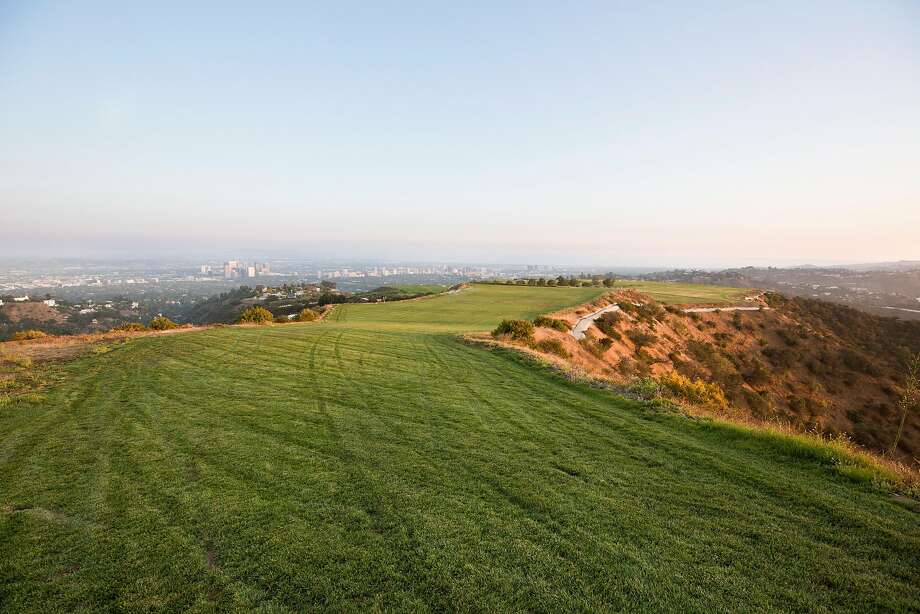 """An undeveloped, 157-acre hilltop plot in Beverly Hills, Calif., July 19, 2018. The land, promoted as the Mountain of Beverly Hills, """"is a crown jewel,"""" its listing agent, Aaron Kirman, said. The asking price? It was a cool $1 billion. Photo: Beth Coller, NYT"""