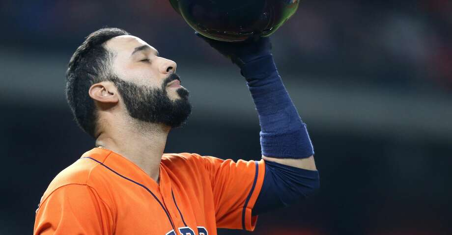 Houston Astros left fielder Marwin Gonzalez (9) react to flying out in the bottom of the fourth inning, leaving two on base against the Texas Rangers at Minute Maid Park on Friday, July 27, 2018 in Houston. Photo: Elizabeth Conley/Houston Chronicle