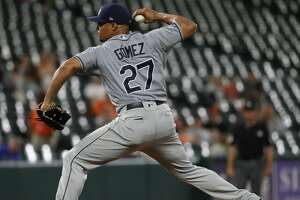 BALTIMORE, MD - JULY 27: Carlos Gomez #27 of the Tampa Bay Rays pitches against the Baltimore Orioles during the eighth inning at Oriole Park at Camden Yards on July 27, 2018 in Baltimore, Maryland. (Photo by Patrick Smith/Getty Images)