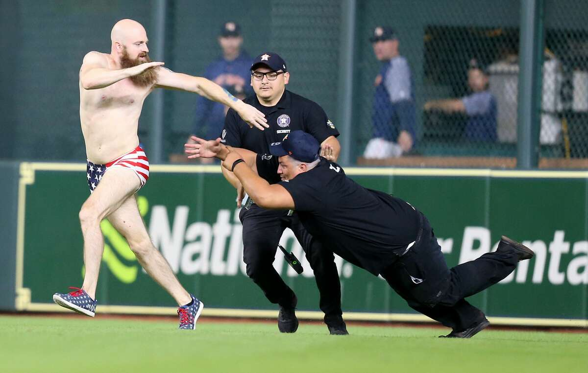 PHOTOS: A look at Friday night's streaker as well as other strange moments that have happened at Minute Maid Park An attendee of the Houston Astros game dodges security after the Astros loss to the Texas Rangers 11-2 at Minute Maid Park on Friday, July 27, 2018 in Houston.