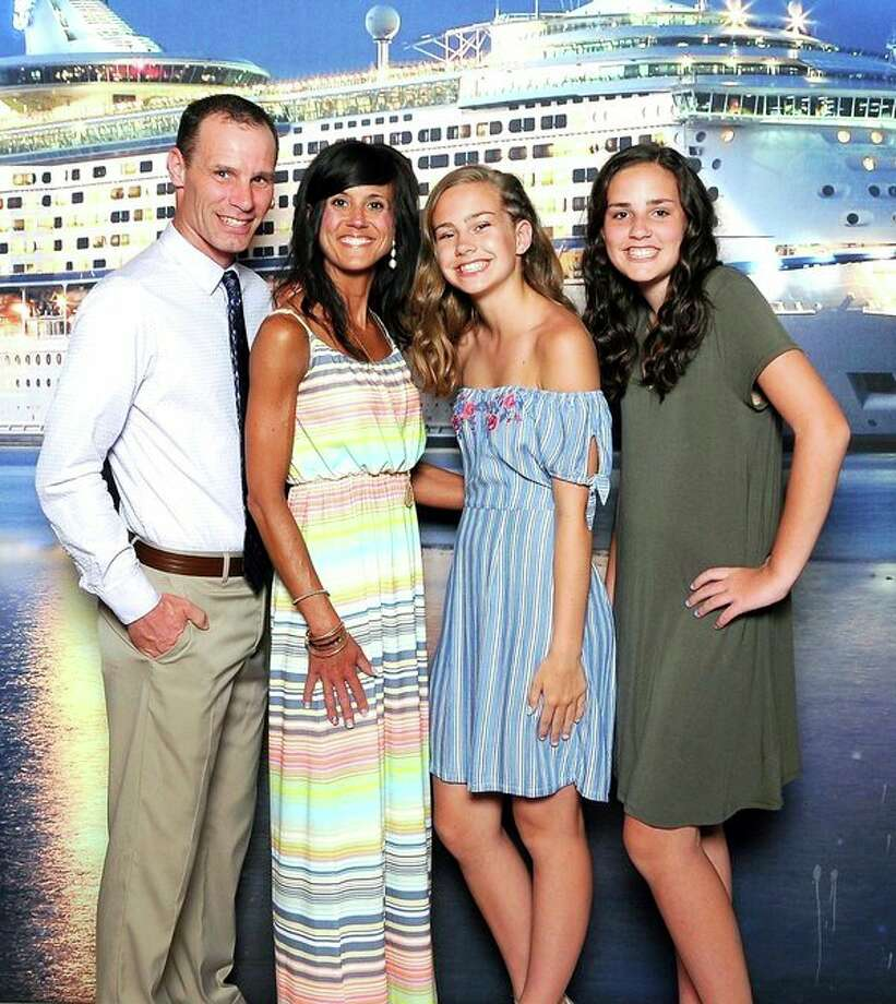 Trever Engler, left, poses with his family on a recent cruise to Aruba. Next to him are his wife, Brenda and daughters, Alayna and Callie. (Submitted Photo)