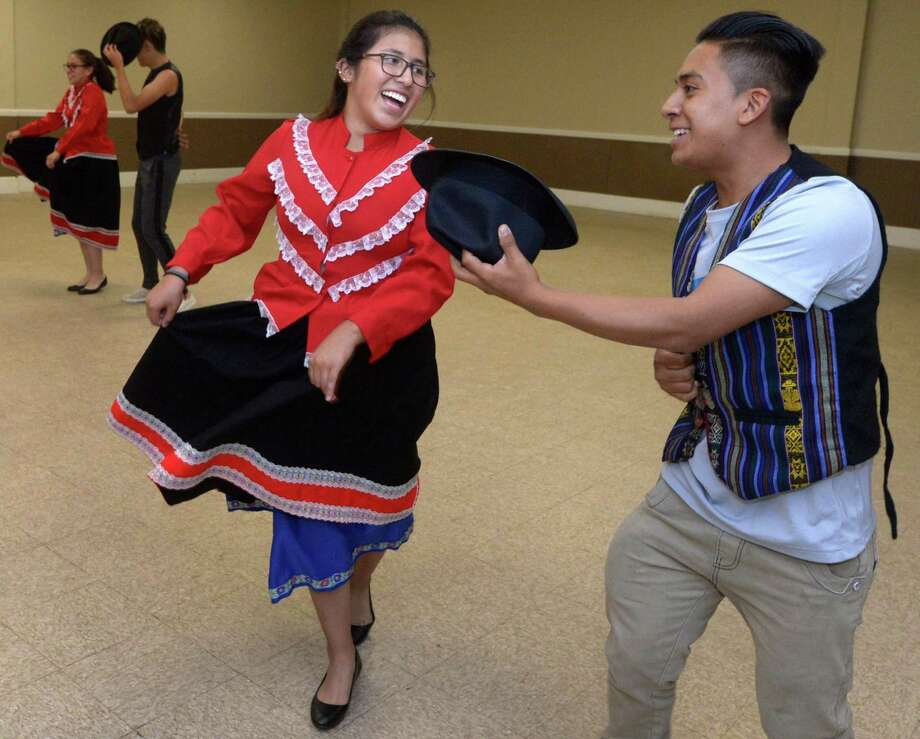 Art students from Norwalk's Ecuadorian sister city, Riobamba, including Daniela Arandi, 17, and Patricio Bacon, 17, learn traditional dance as part of their visit Thursday, July 26, 2018, at the South Norwalk Community Center in Norwalk, Conn. The students have come to Connecticut to study with local instructors in painting and dance in studios in Stamford, Norwalk and New Haven through the Norwalk Summer Arts Program. The group is also taking ESL classes with literacy volunteers during their visit. Photo: Erik Trautmann / Hearst Connecticut Media / Norwalk Hour