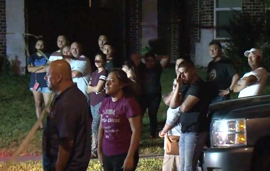 People look at the scene of a west Hardy slaying in which a father of two was slain. Photo: Metro Video