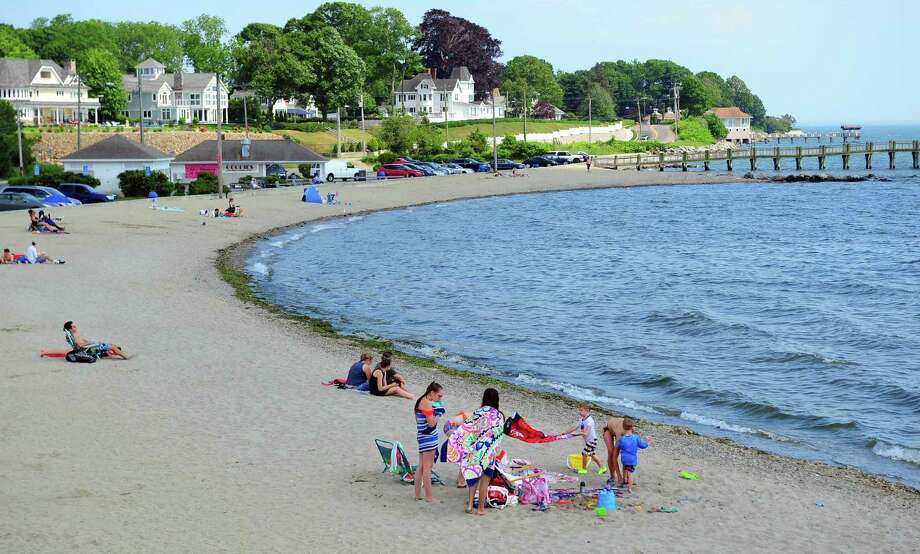 Beachgoers enjoy a Milford beach in this file photo from June 13, 2017. Photo: Christian Abraham / Hearst Connecticut Media / Connecticut Post