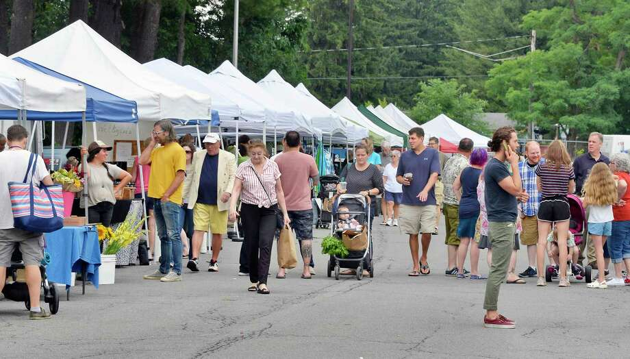 Shoppers at the Delmar Farmers' Market at Bethlehem Central Middle School Saturday July 28, 2018 in Delmar, NY.  (John Carl D'Annibale/Times Union) Photo: John Carl D'Annibale, Albany Times Union / 20044426A