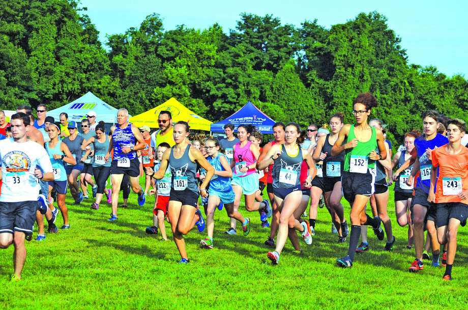 Runners participate in the 23rd annual Mud Mountain 5K on Saturday at the SIUE cross country course. The event is a fundraiser for the cross country and track and field programs at Edwardsville High School, Liberty Middle School and Lincoln Middle School. Photo: Scott Marion