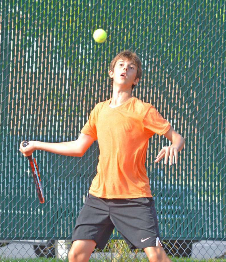 Drake Schreiber, who will be a senior at Edwardsville, makes a forehand return during last year's Pro Wild Card Challenge at the EHS Tennis Center. Photo: Scott Marion
