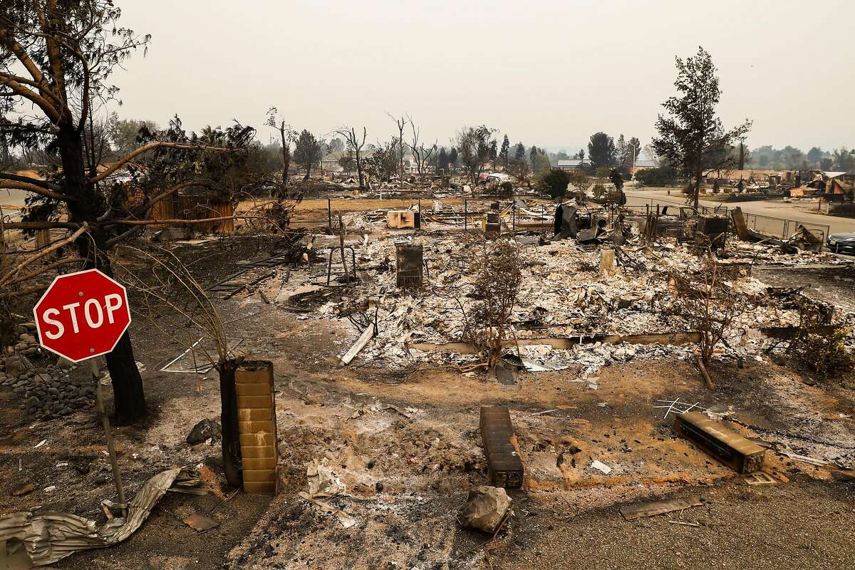 Destroyed properties are seen on Menlo Way and Keswick Dam Road after the Carr Fire destroyed the area in Redding, California, on Saturday, July 28, 2018.