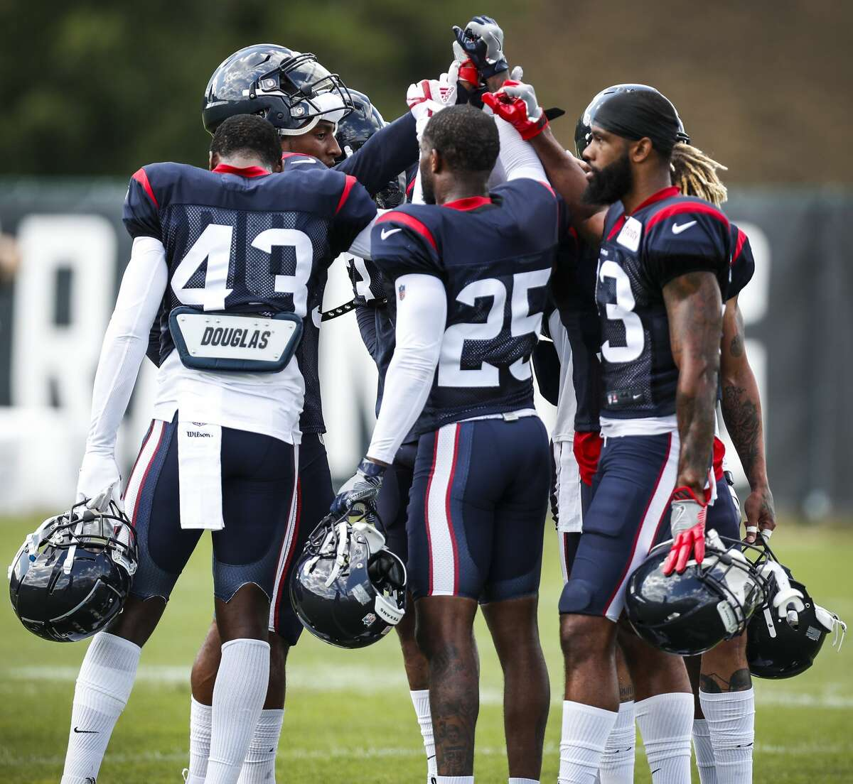 Houston Texans defensive backs huddle up before their next drill during training camp at the Greenbrier Sports Performance Center on Saturday, July 28, 2018, in White Sulphur Springs, W.Va.