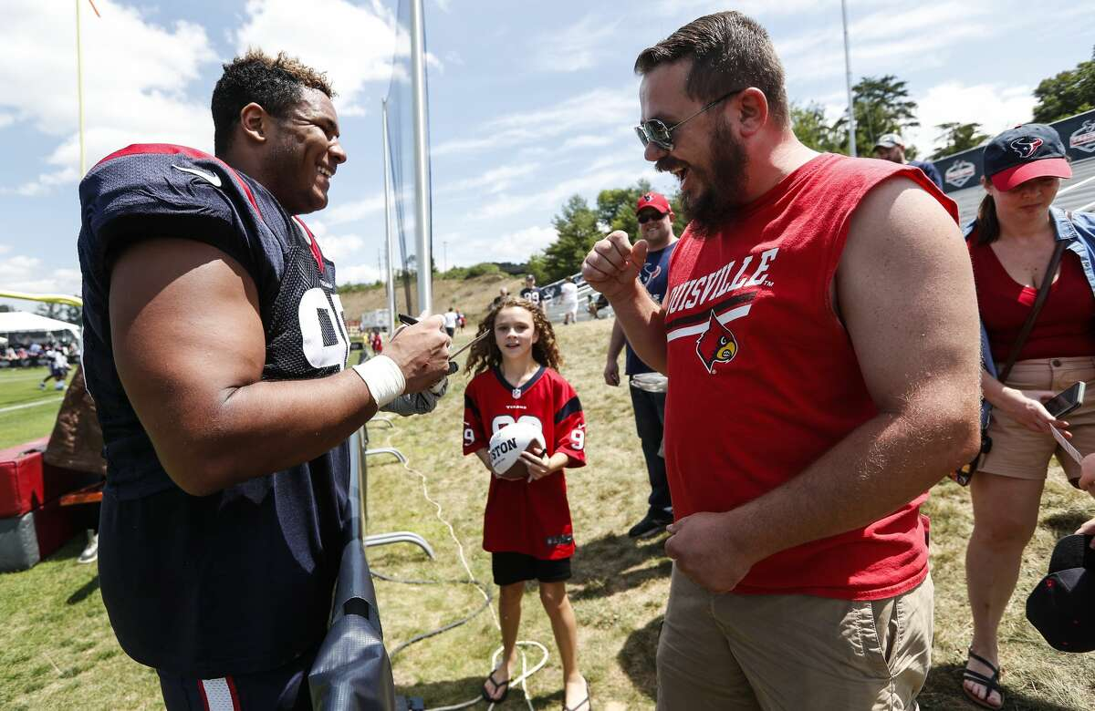 Houston Texans defensive end Christian Covington (95) signs autographs following practice during training camp at the Greenbrier Sports Performance Center on Saturday, July 28, 2018, in White Sulphur Springs, W.Va.