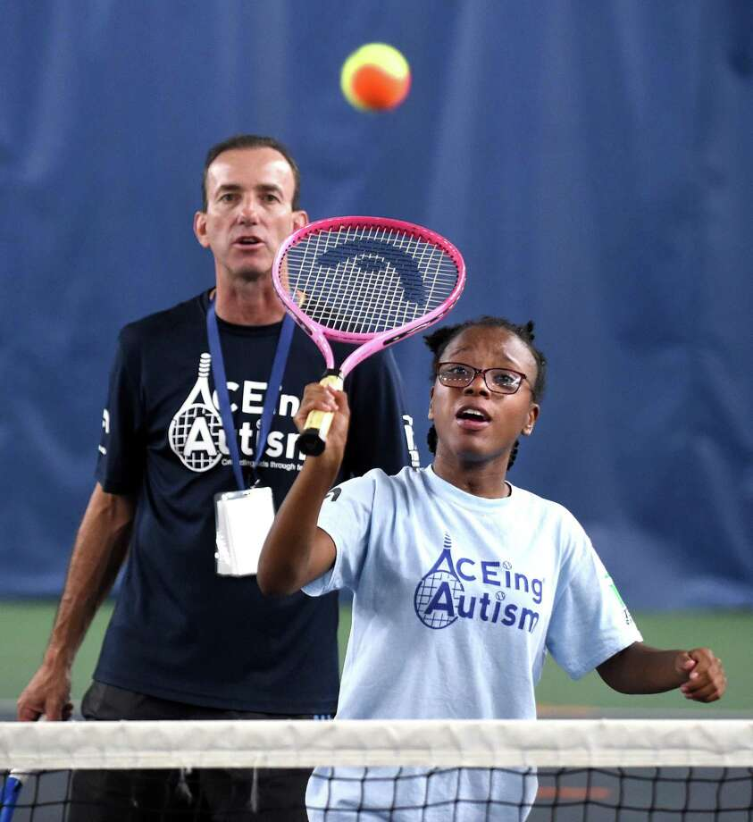 Aceing Autism CT program director Bob Migliorini watches Lauryn Stanley, 14, of New Haven hit the ball during a clinic at the North Haven Health & Racquet Club on Saturday. Photo: Arnold Gold / Hearst Connecticut Media / New Haven Register