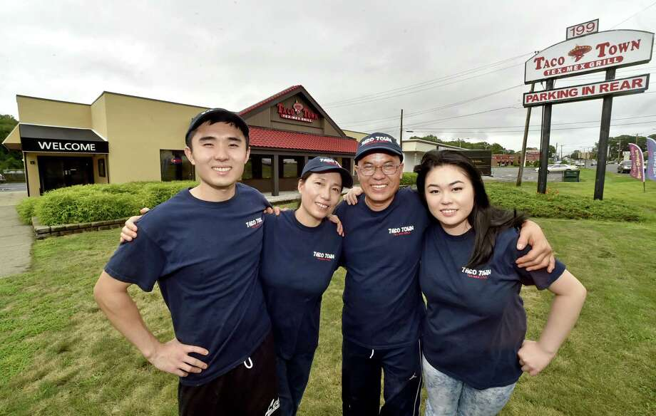 Taco Town Tex-Mex Grill is a family affair with Jonathan Sze, left, and his mother Yuk Ping Sze, father Hak Luen Sze and sister Vivian Sze. Taco Town has been open for a month. Photo: Peter Hvizdak / Hearst Connecticut Media / New Haven Register