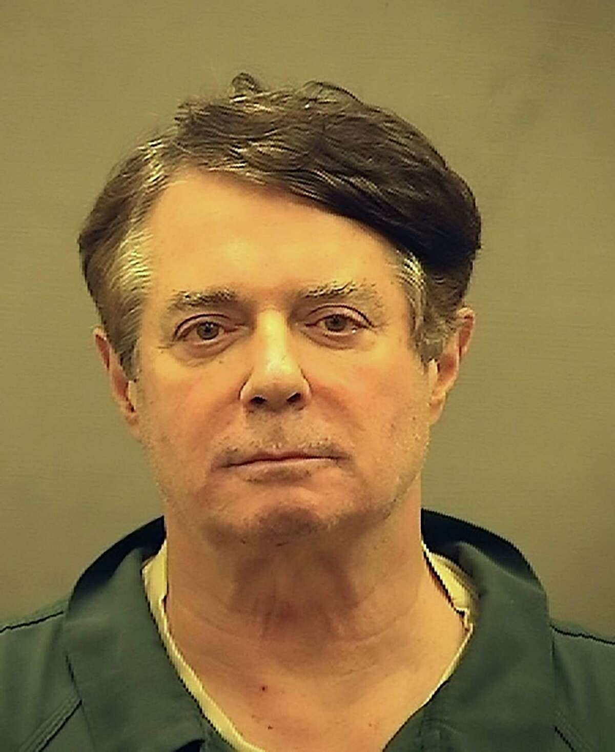 """This photograph obtained courtesy of the Alexandria Sheriff's Office, Paul Manafort, Donald Trump's former campaign chief, is seen in this booking photo July 12, 2018 after his transfer to the Alexandria Detention Center in Alexandria, Virginia. Manafort, who is facing trial later this year on money laundering charges involving his work for Ukraine that predated the 2016 presidential election, is one of 20 people and three companies already indicted by Special Counsel Robert Mueller in the investigation into possible collusion with Russia by the Trump campaign, as well as possible obstruction of justice. / AFP PHOTO / ALEXANDRIA SHERIFF'S OFFICE / HO / == RESTRICTED TO EDITORIAL USE / MANDATORY CREDIT: """"AFP PHOTO / ALEXANDRIA SHERIFF'S OFFICE / HANDOUT"""" / NO MARKETING / NO ADVERTISING CAMPAIGNS / DISTRIBUTED AS A SERVICE TO CLIENTS ==HO/AFP/Getty Images"""