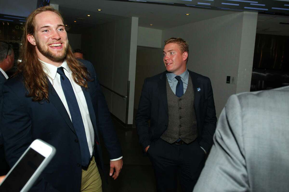 Bryant linebacker and Stamford native Tom Costigan, left, smiles during NEC media day at MetLife Stadium in East Rutherford, N.J. on Tuesday, July 24, 2018.