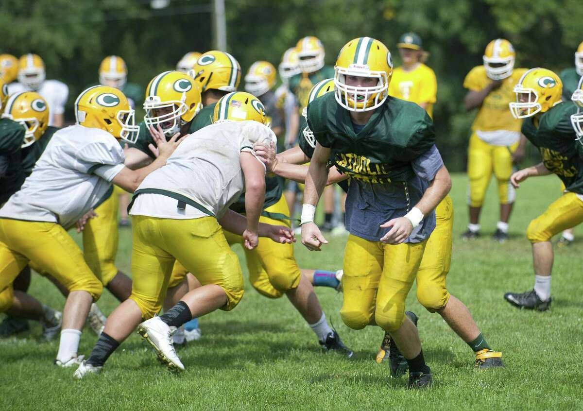Tom Costigan practices with the Trinity Catholic football in 2014.