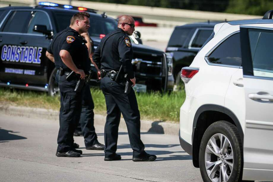 Law enforcement investigate the scene of a violent confrontation between two drivers that were involved in a collision on Saturday, July 28, 2018, on the southbound I-45 service road, near SH 242. Photo: Michael Minasi, Staff Photographer / Houston Chronicle / © 2018 Houston Chronicle