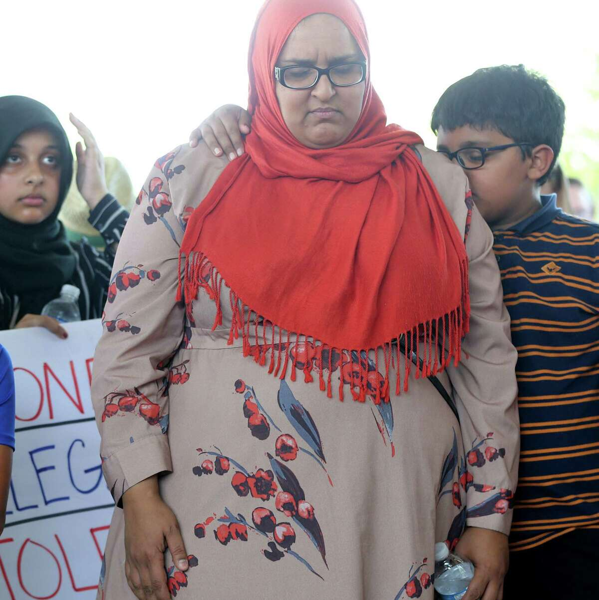 Muhaymin Mohammed, 12, puts his arm around his mom, Amina Ishaq, before a march to the site of the proposed proposed detention center at 419 Emancipation Avenue to call for the reunification of immigrant families separated by the Trump Administration on Saturday, July 28, 2018 in Houston.