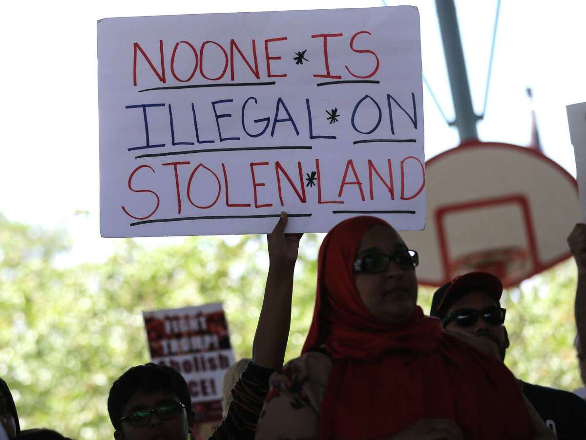 A sign held by an attendee of a march organized by Texas State Senator Sylvia Garcia and partnering organizations to the site of the proposed detention center at 419 Emancipation Avenue to call for the reunification of immigrant families separated by the Trump Administration on Saturday, July 28, 2018 in Houston.