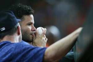Houston Astros second baseman Jose Altuve (27) watches the Astros take on the Texas Rangers from the dugout  at Minute Maid Park on Friday, July 27, 2018 in Houston. Rangers won the game 11-2.