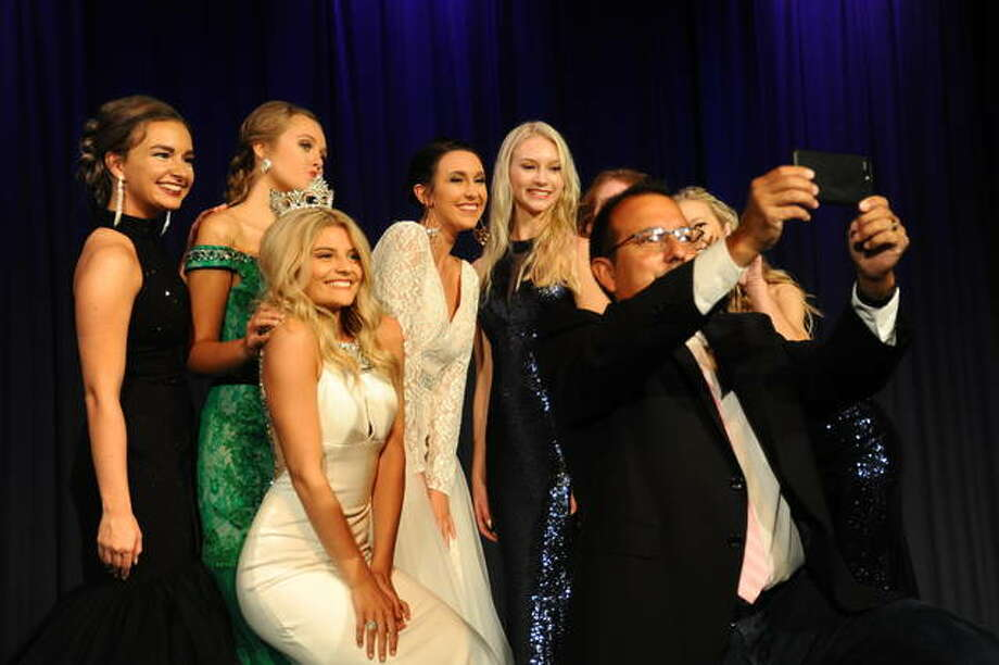 Emcee Phil McDowell takes a selfie with the queen contestants and retiring Queen Madalaina Hlava during Saturday's Miss Madison County Fair Queen Pageant. Photo:       David Blanchette | For The Telegraph