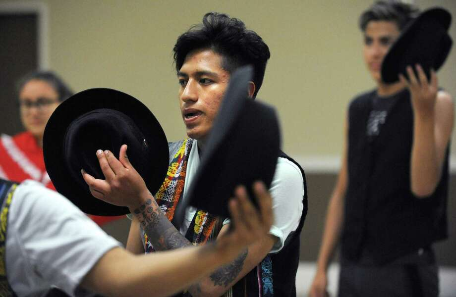 Art students from Norwalk's Ecuadorian sister city, Riobamba, including Xavier Cuji, 17, learn traditional dance as part of their visit Thursday, July 26, 2018, at the South Norwalk Community Center in Norwalk, Conn. The students have come to Connecticut to study with people here through the Norwalk Summer Arts Program in painting and dance in studios in Stamford, Norwalk and New Haven. The group is also taking ESL classes with literacy volunteers during their visit. Photo: Erik Trautmann / Hearst Connecticut Media / Norwalk Hour