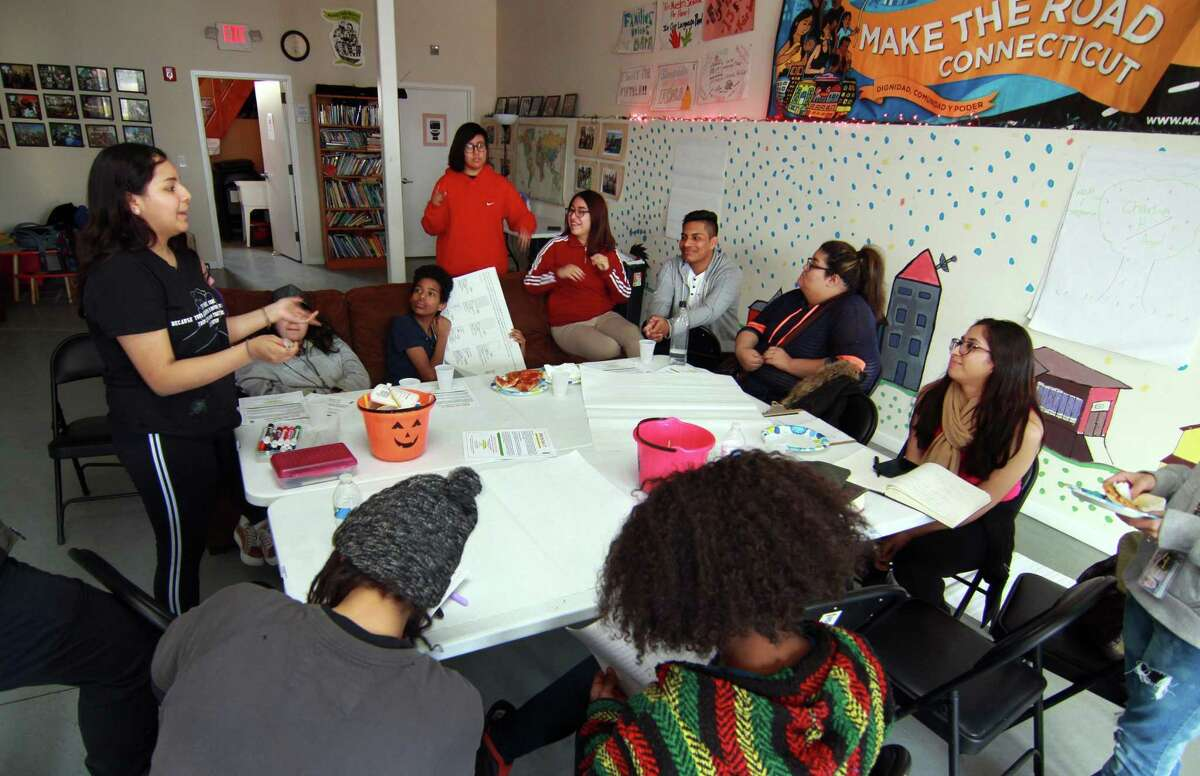 Student Malaska Hernandez, left, gives an update during a weekly Youth Power Committee meeting at Make the Road CT office on State Street in Bridgeport, Conn., on Friday Mar. 16, 2018. The group of mostly immigrant students, have been speaking out for months at city school board meetings about issues that get in the way of their education. The kids will be holding a press conference called