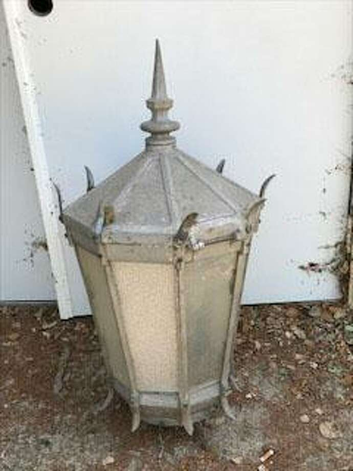 Ron Bird of San Antonio owns this antique street fixture that he was told came from downtown San Antonio, but experts have not been able to identify it as coming from that area. Photo: Courtesy / Ron Bird