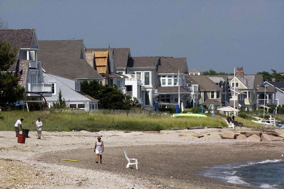 A view of homes facing Long Island Sound along Fairfield Beach Road in Fairfield, Conn., on Friday July 27, 2018. Many of these homes have since been elevated off the ground and placed on piling since the devastation on Superstorm Sandy in 2012. But the flooding from storms like Sandy and Irene before that, don't just leave property damage in its wake -- it can also leave mold, which can carry serious health consequences. Photo: Christian Abraham / Hearst Connecticut Media / Connecticut Post