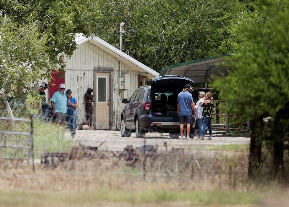People gather Saturday at a home in the 4200 block of west Texas 44 in Robstown where the bodies of a 13-year-old boy and a 40-year-old man were found Friday evening. Their identities had not been released as of Saturday afternoon. Police believe Richard Starry, 60, shot and killed his father, 85-year-old Ernest Starry, and his stepmother, 60-year-old Thelma Montalvo, at Retama Manor nursing home, where he also died. Police said the two people at the home died first and that the crime scenes are related, but would not give details. Photo: Courtney Sacco/Caller-Times / Courtney Sacco/Corpus Christi Caller-Times
