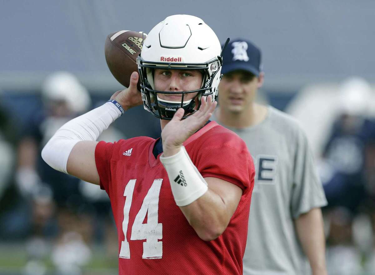 Rice quarterback Jackson Tyner throws warm ups as quarterbacks coach Robbie Picazo looks on during a football practice at Rice Stadium Friday July 27, 2018 in Houston, TX. Michael Wyke/Contributor