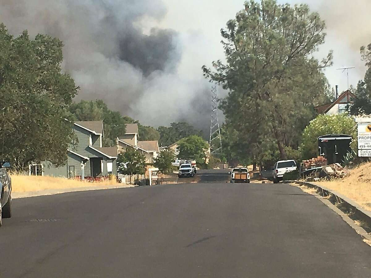 A wildfire was burning structures and prompted an evacuation order in the Berryessa Highlands neighborhood south of Lake Berryessa in Napa County on Saturday.