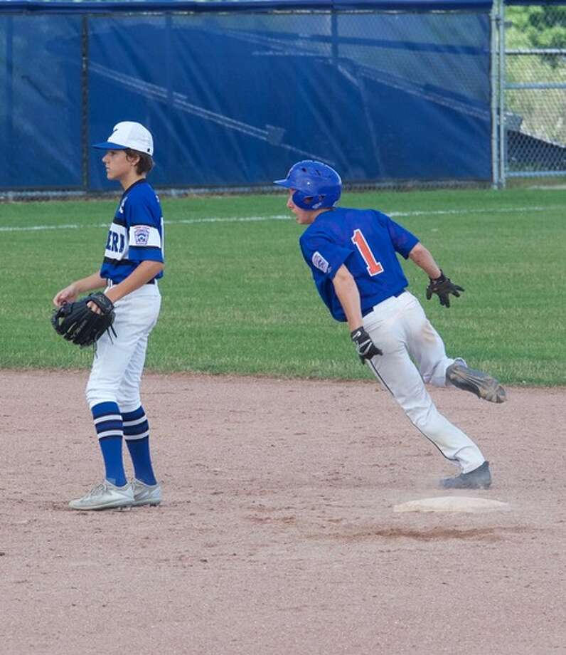 Midland's Noah Reuter-Gushow rounds second base during a 13-3 win over Norway on Saturday at the Junior League Baseball state tournament in Petoskey. (Photo provided by Jill Gushow) Photo: Photos Provided By Jill Gushow