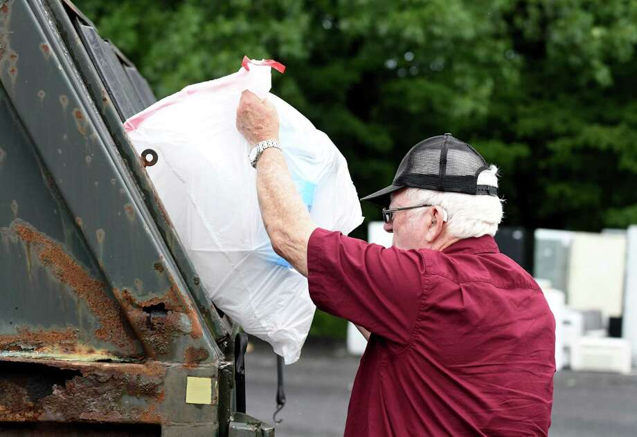 Tim DeVost, 78, of Glenmont dumps his plastic recyclables at the Bethlehem Recycling Center on Thursday, July 25, 2018, in Selkirk, N.Y. (Will Waldron/Times Union) Photo: Will Waldron / 20044434A