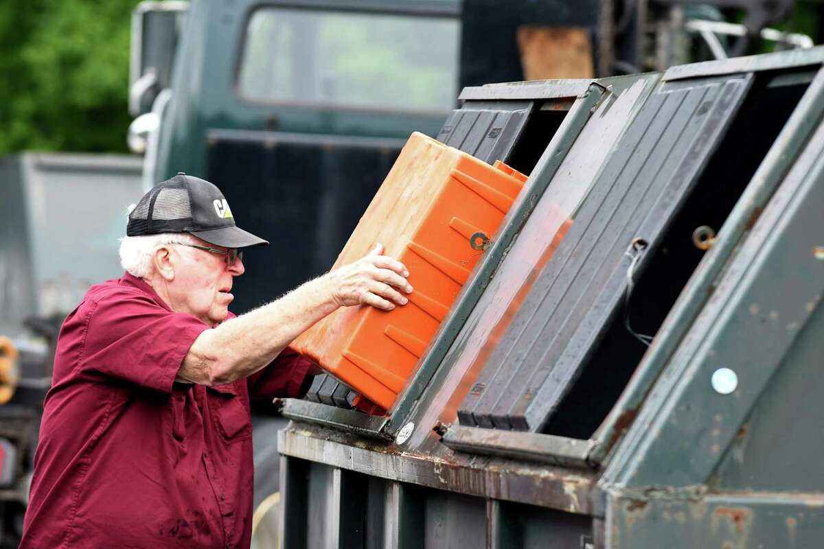 Tim DeVost, 78, of Glenmont dumps his plastic recyclables at the Bethlehem Recycling Center on Thursday, July 25, 2018, in Selkirk, N.Y. (Will Waldron/Times Union)