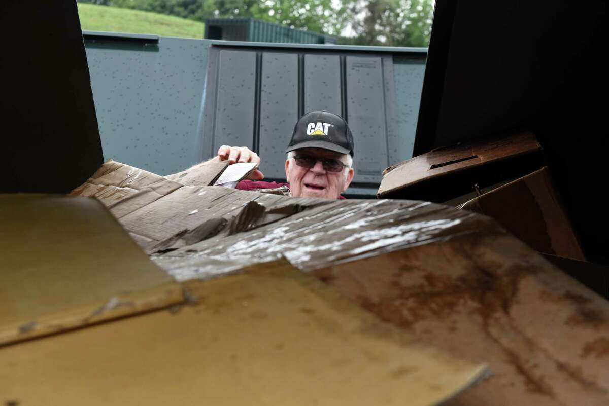 Tim DeVost, 78, of Glenmont dumps his cardboard recyclables at the Bethlehem Recycling Center on Thursday, July 25, 2018, in Selkirk, N.Y. (Will Waldron/Times Union)