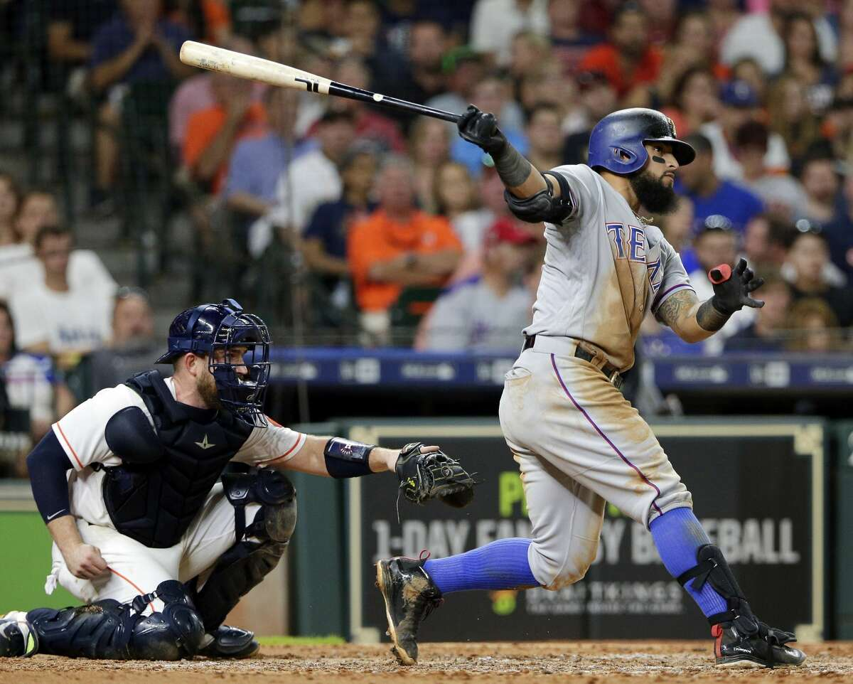 Texas Rangers' Rougned Odor, right, watches his second home run of the night in front of Houston Astros catcher Max Stassi during the seventh inning of a baseball game Saturday, July 28, 2018, in Houston. (AP Photo/Michael Wyke)