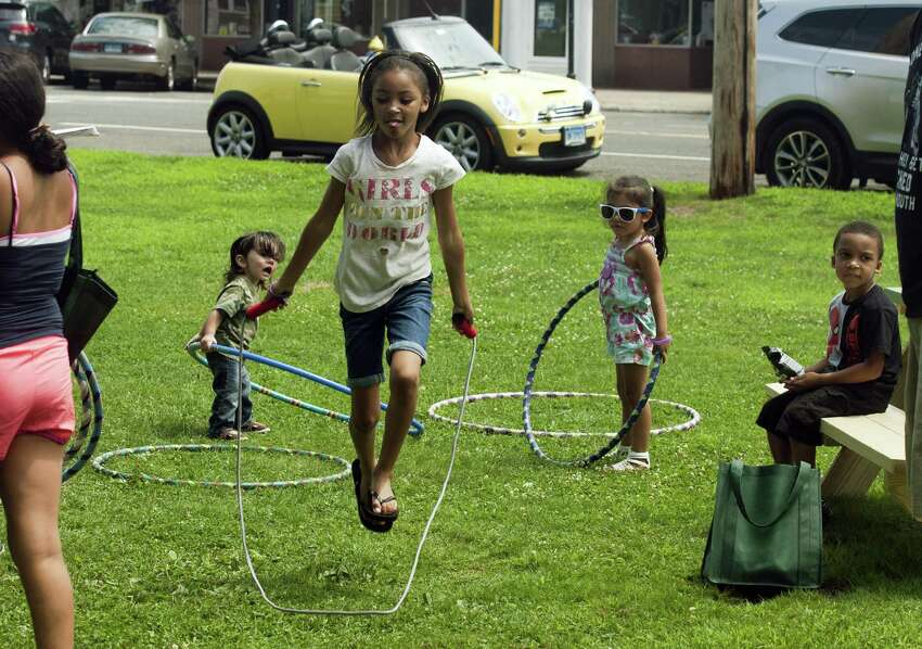 Breyanna Tucker, 7, of Bridgeport, jump rope during Family Fitness Day on Paradise Green in Stratford, Conn., on Saturday, July 28, 2018. The event, held by Get Healthy CT, coincides with National Dance Day and encourages area residents of all ages to be physically active and eat healthy foods.