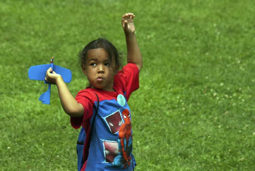 Bryan Colon, 5, of Bridgeport, plays with a toy airplane during Family Fitness Day on Paradise Green in Stratford, Conn., on Saturday, July 28, 2018. The event, held by Get Healthy CT, coincides with National Dance Day and encourages area residents of all ages to be physically active and eat healthy foods.