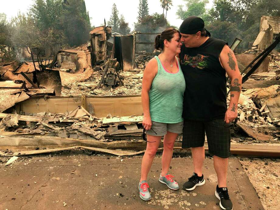 Greg and Terri Hill embrace in front of the charred remains of their home in Redding, Calif., on Friday, July 27, 2018. The couple's home was destroyed by the so-called Carr Fire. (AP Photo/Jonathan Cooper) Photo: Jonathan Cooper / AP