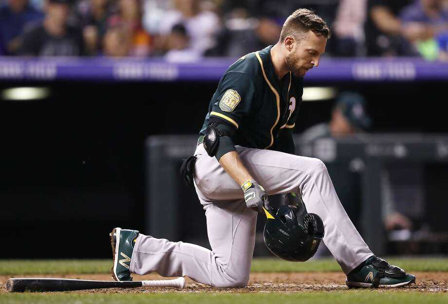 Oakland Athletics' Jed Lowrie reacts after striking out against Colorado Rockies starting pitcher Antonio Senzatela in the fifth inning of a baseball game Saturday, July 28, 2018, in Denver. (AP Photo/David Zalubowski) Photo: David Zalubowski / Associated Press