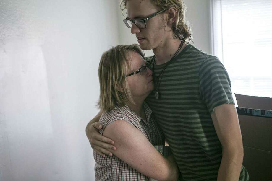 Branson Fairbrother embraces his mom, Regina Fairbrother, as she starts to tear up while remembering a phone call she received from him July 20, telling him about the fire at Iconic Village Apartments. He lived in Building 500, which was destroyed, but he didn't stay there that night.  Five young adults were found dead and a sixth was critically injured in the fire. Photo: Josie Norris /Staff Photographer / © San Antonio Express-News