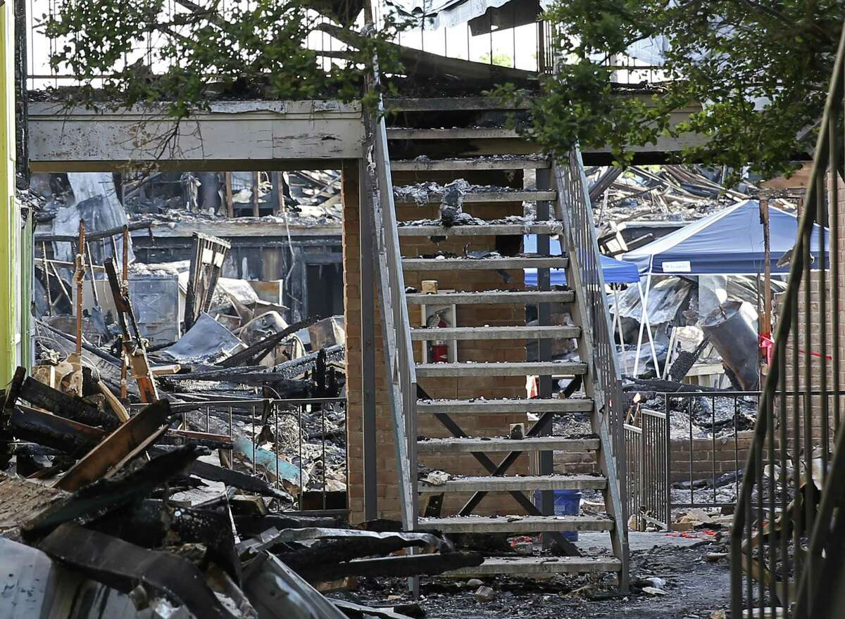 A view into the courtyard and the remains of Building 500 at Iconic Village Apartments in San Marcos. The fire, which started shortly before 4:30 a.m. July 20, left five people dead and displaced 200 residents. The last body was recovered July 23.